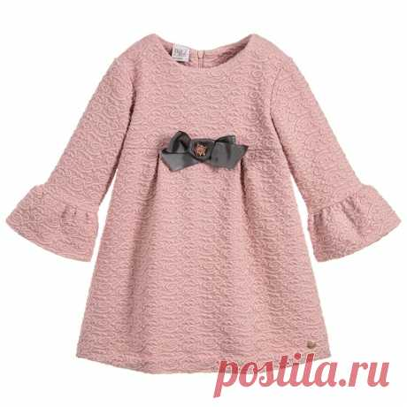 Girls Pink Jersey Dress  Girls dusky pink dress with bell sleeves by Paz Rodriguez. Made in a soft and stretchy jacquard fabric and decorated on the front with a grey grosgrain ribbon bow and a glittering crystal jewel in the centre.