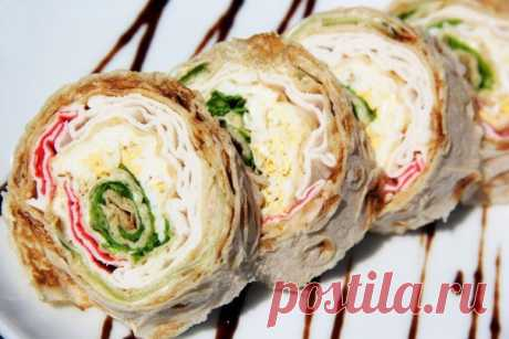 Roll from an unleavened wheat cake with crabsticks and a cucumber.\u000a\u000aRoll from an unleavened wheat cake with a stuffing is a tasty and fast snack which can be prepared on a holiday table or on picnic. It is possible to experiment with stuffings, selecting under the taste. This time I made roll of an unleavened wheat cake with crabsticks and a cucumber.\u000aTo show completely …