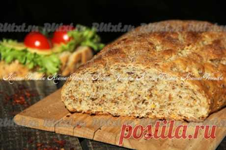 Хлеб с пшеничными отрубями от nichka с нежным, пористым мякишем и тонкой, хрустящей корочкой.  мука пшеничная - 250 г; молоко - 100 мл; вода - 100 мл; отруби пшеничные - 50 г; растительное масло - 2 ст. л. (в тесто) + для смазывания пергамента и рук; соль - 1,5 ст. л.; мёд - 1 ч. л.; дрожжи сухие - 1 ч. л.; семена льна - 2 ч. л. (по желанию); семена подсолнуха - 1 ч. л. (по желанию).