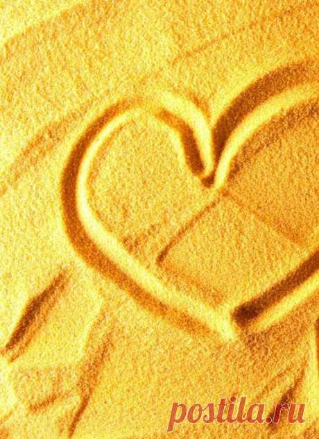 yellow heart in sand