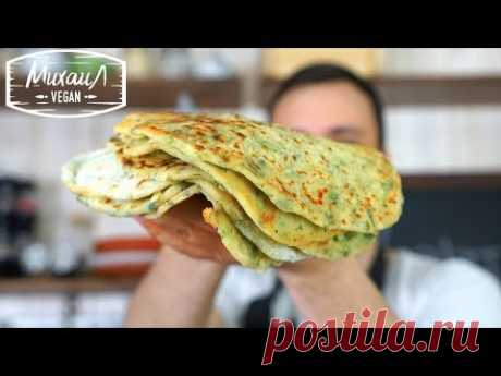 Potato flat cakes with greens on a frying pan