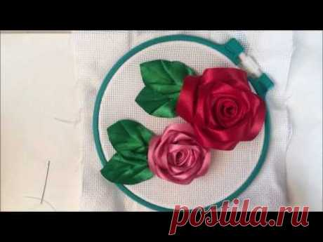 The rose embroidered with tapes (from separate petals)