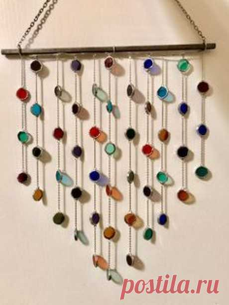 This whimsical and vibrant sun catcher to brighten up any space! The cheery colors will perfectly compliment all seasons and every hint of light will bring a smile to your face. It falls into a lovely shape when hanging. A variety of colors are featured including shades of green, red, purple, amber,