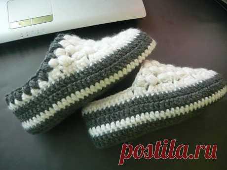 Las zapatillas calientes tejidas