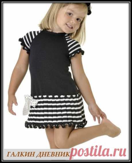 Эффектное платье для девочки связанное спицами
