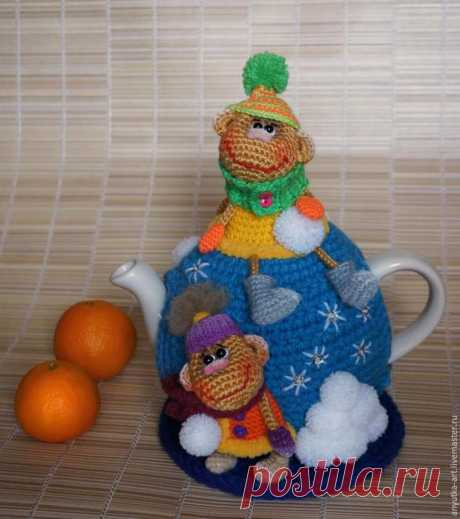 We knit a new hot-water bottle on a teapot with a symbol of year — nice monkeys