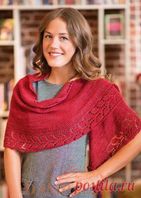 Knitted cape with an openwork border.