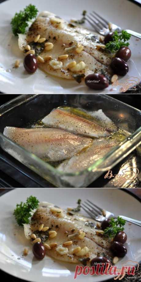 Рыба с маслинами, кедровыми орешками,базиликом и вином