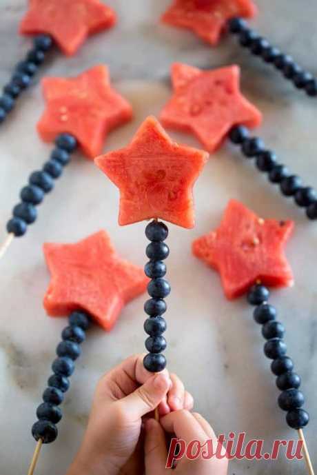 Просмотры (2) · 15 минут · Порций: 20 · Fruit Sparklers made with watermelon cut into stars and blueberries stacked on a bamboo skewer.
