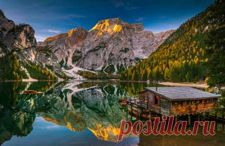 Southern Alps On my last trip to Italy I stopped off at the Lago di Braies. It was early morning and the sun gave the mountain ridge a golden glow. The lake was almost completely flat and reflected the whole scene like a perfect mirror image.
