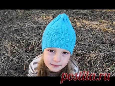 Весенне-осенняя шапочка тыковка спицами 3,25 и 3,5 из вискозы на объем головы 51-54 см. Шапочка начинается с вязания резинки 2х2, которая постепенно переходит на резинку 4х4. Весной в ней будет совсем не жарко.