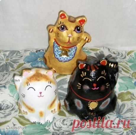 Maneki Neko is a cat of good luck | the Country of Masters