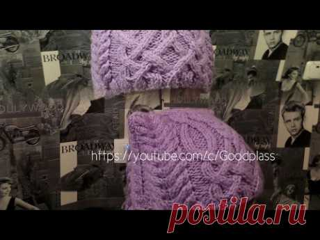 Knitted cap with ears. Knitting by spokes. A cap a cat with a braid. Knitting(Hobby)