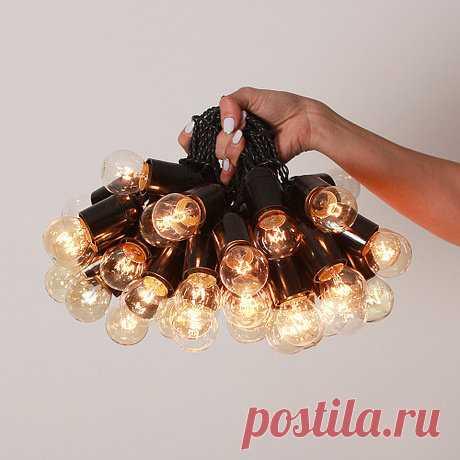 Ретро гирлянда с лампами накаливания Эдисон на 45 лампочек - Купить за 7013 руб. на INMYROOM.ru Ретро гирлянда из ламп накаливания на витом проводе, длина — 15 метров + подвод к розетке — еще 3 метра. Лампочки с цоколем E27 (45 шт) входят в комплект. Расстояние между лампочками — 30 см.