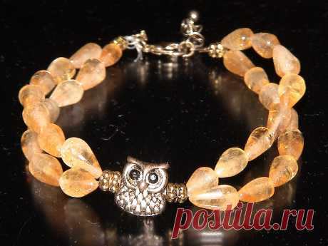 Bracelet from amber with an owl.