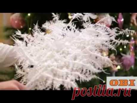 'Snow-covered' flowers and branches in a New Year's interior