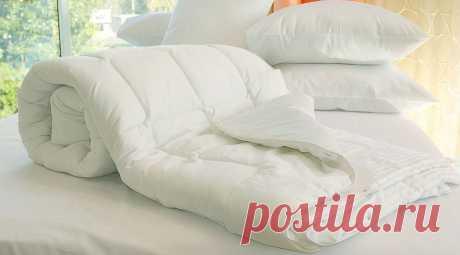 Можно ли и как постирать одеяло из синтепона: в стиральной машине или вручную?