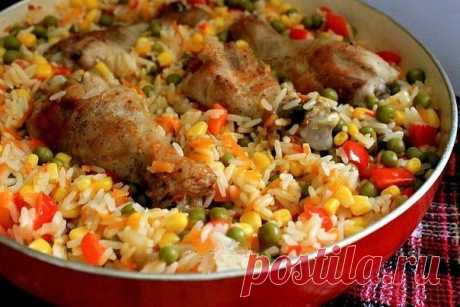 Chicken and rice and vegetables in Catalan.