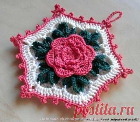 Knitting by a hook. Roses.
