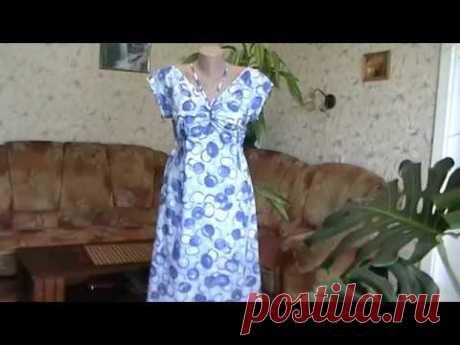 Платье с короткими цельнокроеными рукавами и ластовицей.