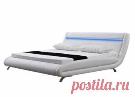 """Кровать Corso-7 Очень изящная кровать в футуристическом стиле. Хромированные высокие ножки, мягкая LED подсветка изголовья и оригинальные округлые боковины украсят собой любую спальню. Модель изготовлена из ДСП и МДФ. Обивка кровати выполнена из экокожи класса """"люкс"""". Кровать поставляется без основания. Вы можете выбрать одну из подходящих моделей. Доступно два варианта крепления основания. По необходимости основание можно установить выше и ниже. Обратите внимание, что угл..."""