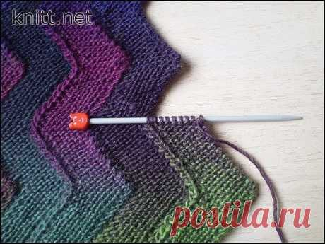 """Одеяло """"Зигзаг"""" из 10 петель   Урок по вязанию одеяла методом набора полосок. Все связывается  постепенно не требуя сшивания частей. Используя этот метод можно связать  одеяло из остатков ниток.  Размер: 122 см х 89 см  Вам потребуется:  15 мотков пряжи Rico Design Creative Poems Aran (100% шерсть, 100 м/ 50  г), спицы 4.5 мм Полоски соединяются по мере вязания без сшивания, в результате  получается двухстороннее полотно. Каждая полоса может быть связана из  другой пряжи, ..."""