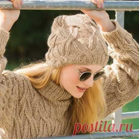 Шапочка с эффектным плетеным узором, вязанная спицами Шапка с необычным и очень эффектным узором поможет вам обратить на себя внимание и защитит от холода.