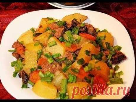 Говядина тушенная с черносливом и овощами в духовке