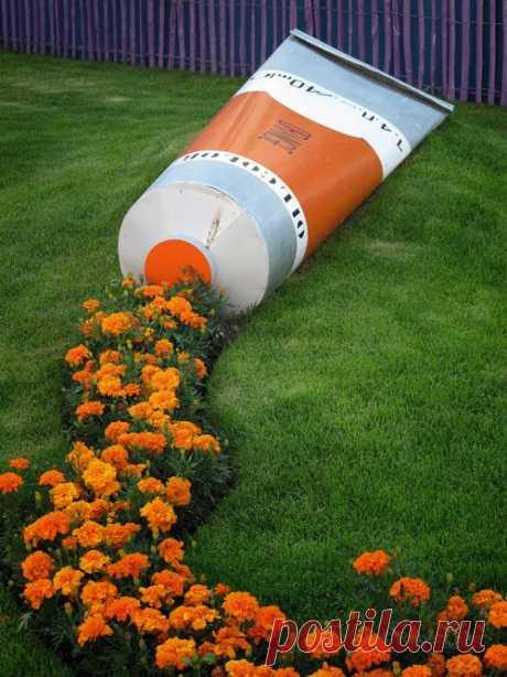 Еще в копилку интересных идей для цветочных клумб.
