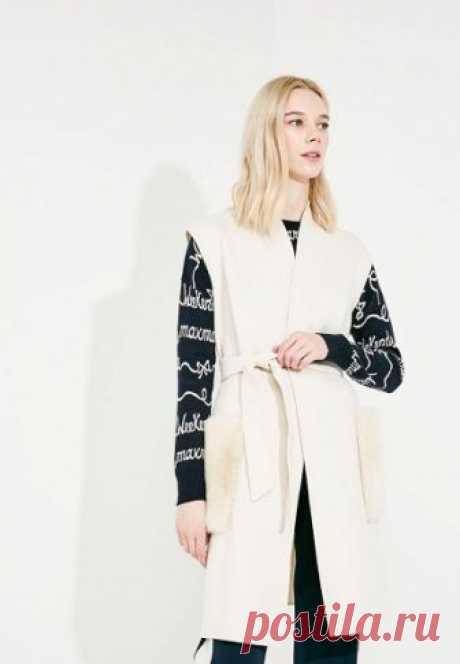 Жилет утепленный Weekend Max Mara  за 42 699 руб. в интернет-магазине Lamoda.ru Жилет от премиум-бренда Weekend Max Mara выполнен из плотного материала на основе шерсти. Особенности: прямой крой, без застежки, два накладных меховых кармана, пояс.