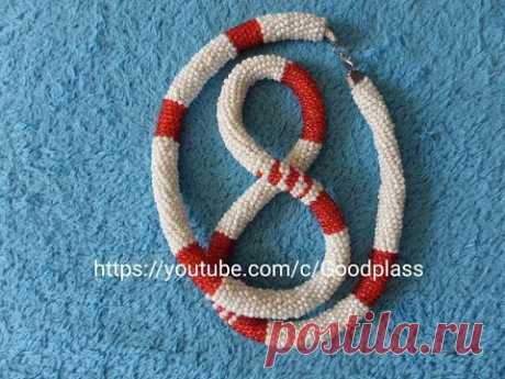 Knitted plait from beads. Knitting by a hook. Beadwork.