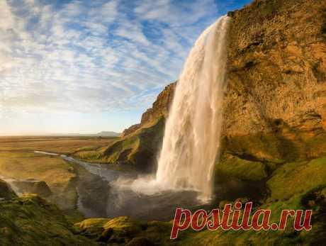 Водопад Сельяландсфосс, Исландия. Автор фото — Кирилл Трубицын: nat-geo.ru/photo/user/50918/
