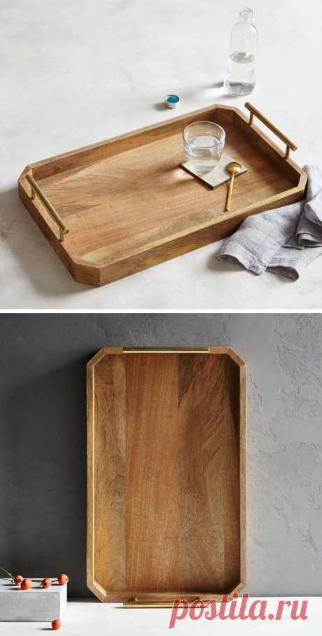The sides of this wood tray eliminate the worry of things being knocked off, and the bar handles on both sides of the tray make it easy to transport and move when necessary.