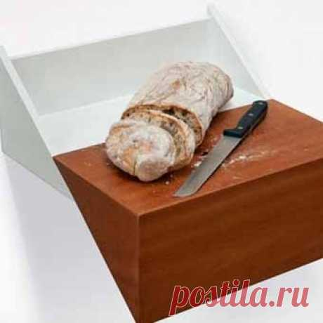 ... the bread box turns. in a chopping board with an opening for storage of a knife