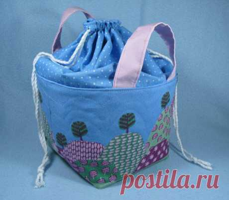"""Drawstring Top Fabric Basket """"Learn how to make a fabric basket with a drawstring top - a drawstring bag and a fabric basket with handles. The handles make it easy to carry, whilst the drawstring top prevents things from falling out, as well as providing more room for storage. The quilting to the basket itself adds structure, making this a basket that will stand up by itself. Change the colours to suit the decor. Made in 'little boy' fabric, this basket makes great st..."""