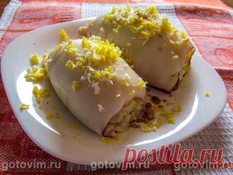 Фаршированные рисом и яйцом кальмары в духовке