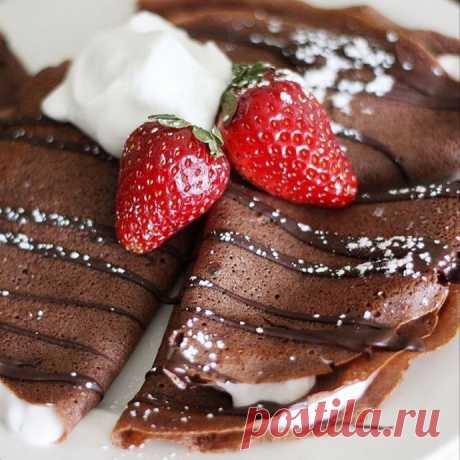 Chocolate pancakes on milk.