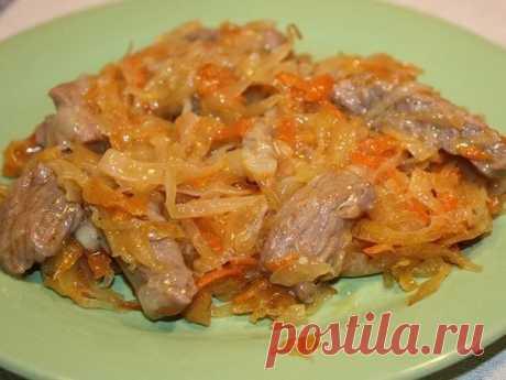 Smart goulash with sauerkraut in a pot. Very tasty