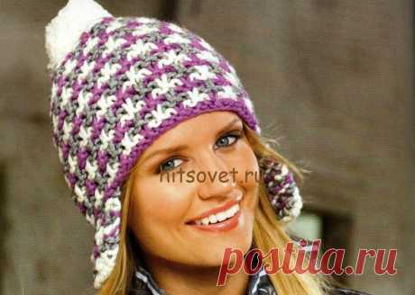 Cap with earphones spokes - Hit council the Cap with earphones spokes. Fashionable model of a cap with a beautiful pattern with the step-by-step description of knitting. It will be required to you: on 50 grams of a white, lilac and gray yarn of Schachenmayr SMC Boston consisting of 70% of polyacryle, 30% of wool thread of 55 meters long in 50 grams; set of chulochny spokes No. 7; a set for pompons.
