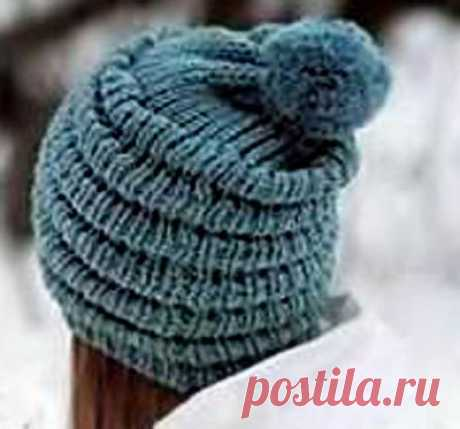 Winter hat spokes with folds and a pompon | Knitting of Caps - Fashionable and New Models