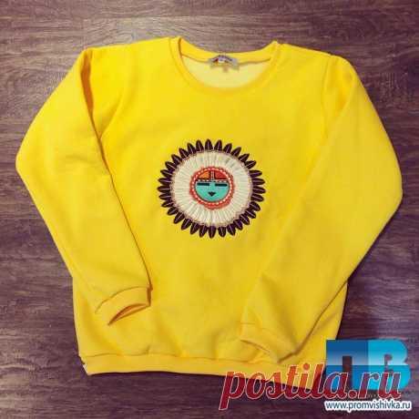 Этническая вышивка на одежде в виде индейского тотема