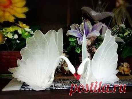 How to make swan by fb:ployandpoom (ผ้าใยบัว) วิธีทำหงษ์ผ้าใยบัว https://www.facebook.com/nylonflowerployandpoom/ Equipment Nylon fabric for make a flower wh...