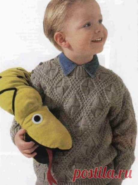 Knitting by a hook and spokes - the Pullover for the boy a fantasy pattern