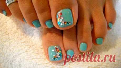 Beautiful pedicure with pastes. Elegant design of nails standing