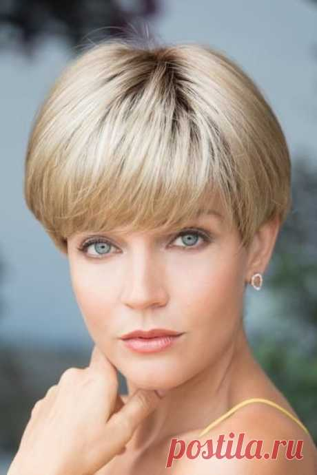 """Sport this stylized, retro bowl cut wig with a chic modern twist. Cap Size: AverageLength: Fringe 3.7"""", Crown 6.3"""", Nape 1.4""""Weight: 2.6 oz Color Shown: Creamy Toffee-R, Marble Brown-R Colors: Cappucino, Cherrywood, Chocolate Frost, Creamy Blond, Ginger Brown, Midnite Pearl, Silver Stone, Bubblegum-R, Champagne-R, Crea"""