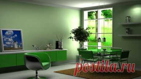 Кухня, в зеленых тонах, как и природа просматриващаяся из окна.