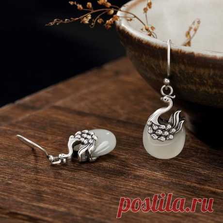Beautiful Hetian jade Phoenix earrings / vintage 925 silver Phoenix earrings / Dangle & Drop Earrings/ Bohemian earrings Product Details:  Material: 925 silver, Hetian jade  color: White  Shape: Phoenix  Size: length 18, width 11 mm.  Weight: 6 grams  Translucent: translucent  Symbol: Good luck to you