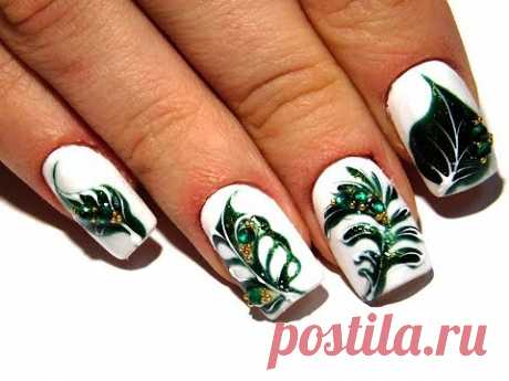 TOP Beautiful design of nails. Green leaves on white 2017 novelties from the manicurist of nail 2017