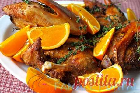 Duck with oranges in an oven