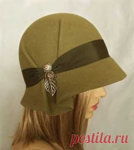 This beautiful ladies cloche is made from fur felt, and hand draped over an antique hat block. Hand finished with authentic millinery techniques, and embellished with grosgrain ribbon, and vintage buttons and toggles (these will vary depending on supply). Please indicate your head size measurement